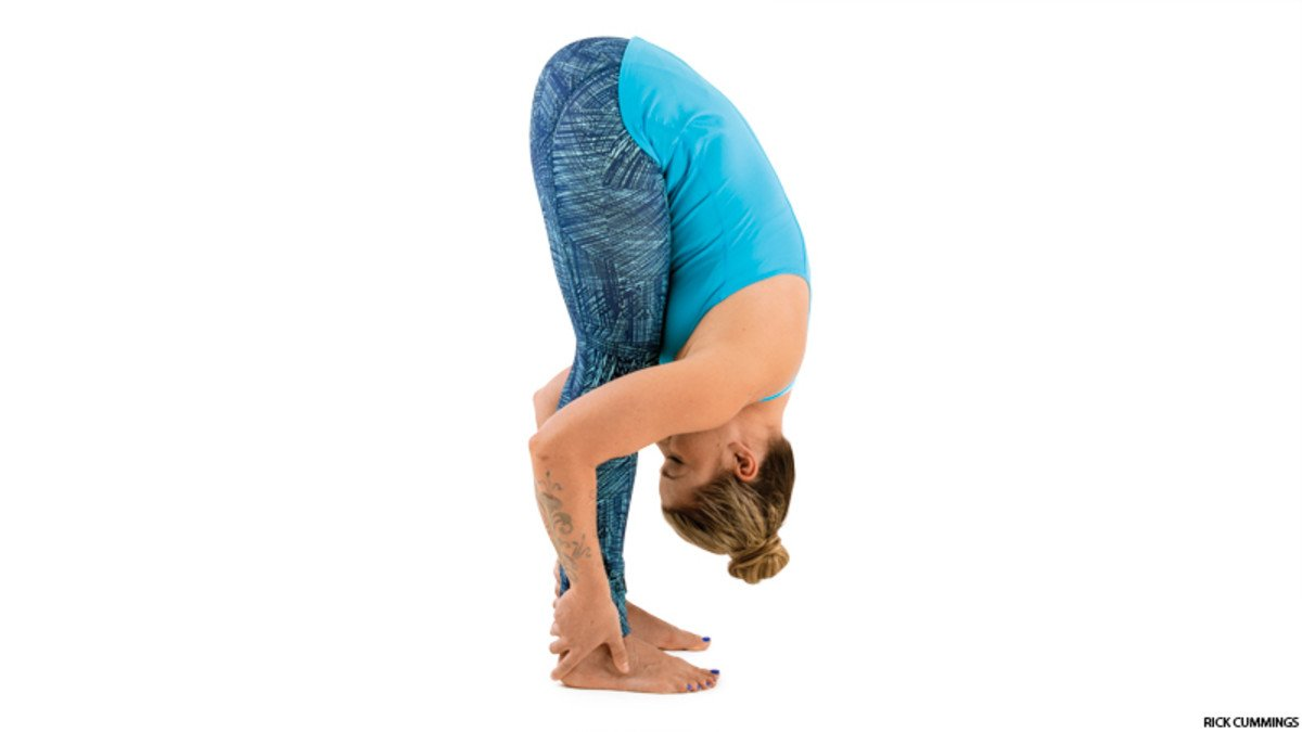 lady doing forward bend pose